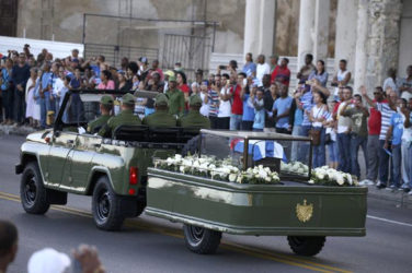 A military vehicle transports the ashes of Cuba's late President Fidel Castro at the start of a three-day journey to the eastern city of Santiago, in Havana, Cuba, November 30, 2016. REUTERS/ Alexandre Meneghini