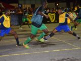 Crunching Challenge- Broad Street Bullies Rocky Gravesande (2nd from right) thwarting a Howes Street-A offensive move with a hard tackle at the Demerara Park in Guinness 'Greatest of the Streets' Georgetown Zone