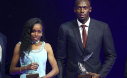 Usain Bolt of Jamaica (R) and Almaz Ayana of Ethiopia pose with their awards after being elected male and female World Athlete of the Year 2016 in Monaco, December 2, 2016. (REUTERS/Eric Gaillard)