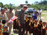 Britain's Prince Harry charms these pupils of the Kurupukari Annex School who greeted him on his arrival at Iwokrama yesterday. See photos on centre pages. (Photo by Keno George)