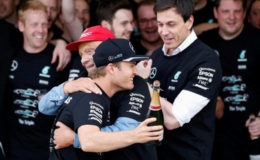 Japanese Grand Prix - 9/10/16. Mercedes' driver Nico Rosberg of Germany celebrates with Mercedes' nonexecutive chairman Niki Lauda and team principal Toto Wolff after they won the Constructors' Championship title for the 2016 season... (REUTERS/Toru Hanai)