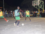 Sheldon Profitt (no.7) of Leopold Street initiating an attacking play while being watched closely by Carl Tudor (right) of North East La Penitence in the 7th Guinness 'Greatest of the Streets' Georgetown Zone at the Burnham Court.