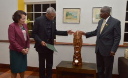 President David Granger (second from left) describing the elements of this Winslow Craig work, 'The Chief Witness to the Environment', which the President gifted to the Barbadian Prime Minister Freundel Stuart on the occasion of Barbados' 50th anniversary of Independence. The President and First Lady Sandra Granger (left) were guests of Barbados for the celebrations. (Ministry of the Presidency photo)