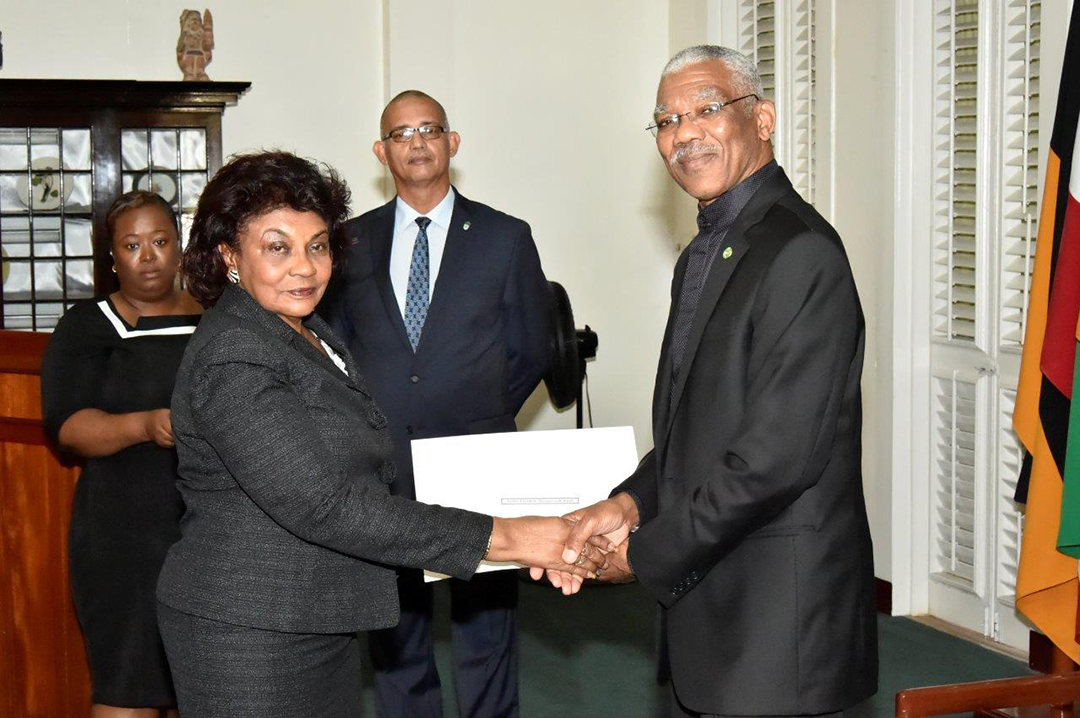President David Granger presenting retired judge Claudette Singh with her Commission of Appointment as Senior Counsel in 2017. (Ministry of the Presidency photo)