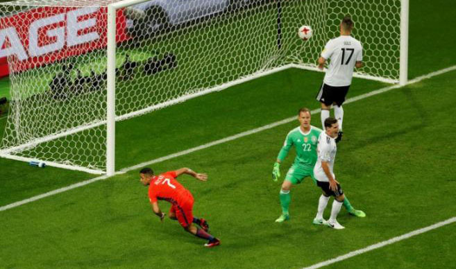 Germany beat ten-man Cameroon to win group
