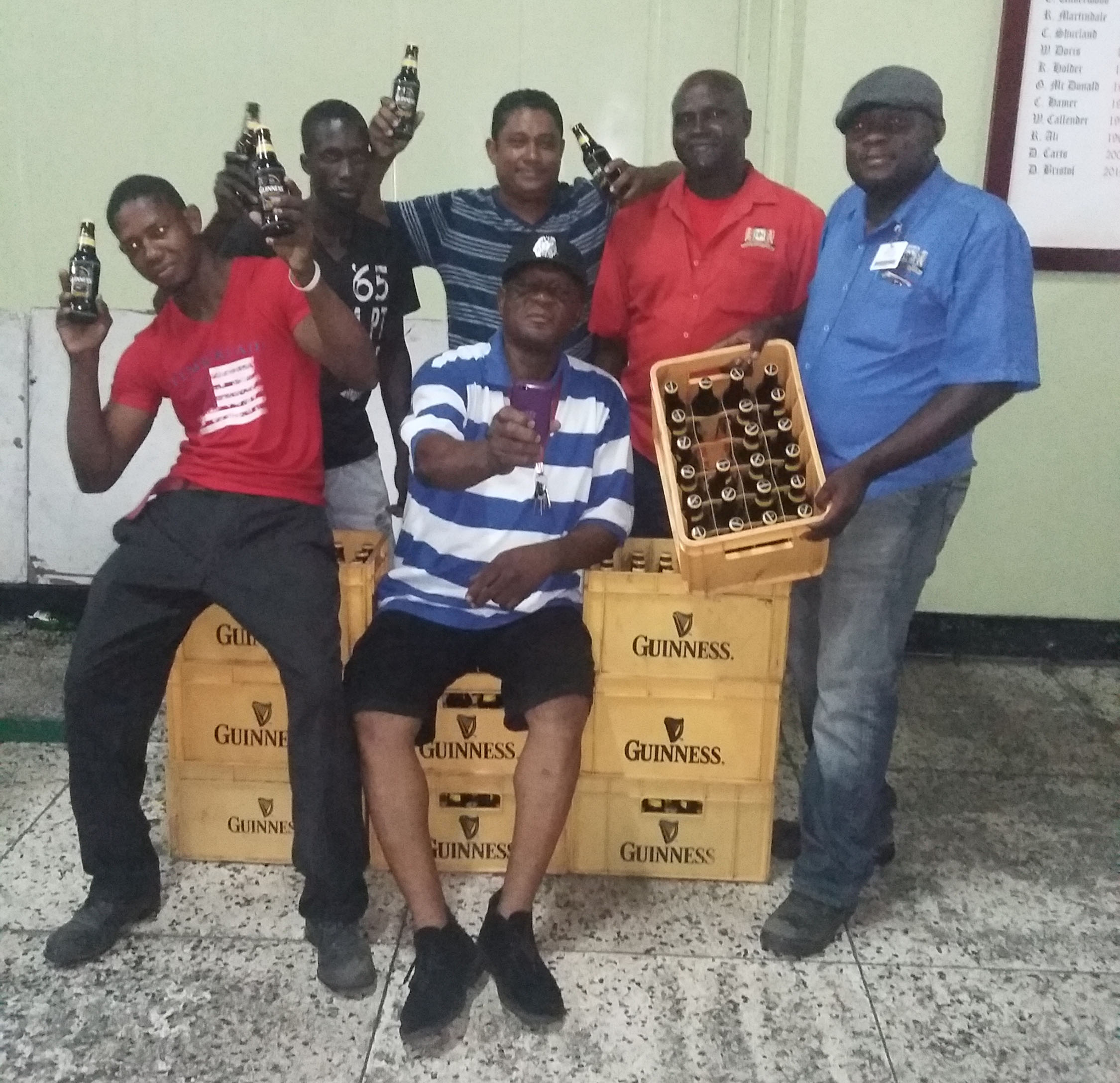 The opening match of the inaugural guinness inter national champions - Champions At Last The Victorious Sales Department Unit With The Spoils Following The Conclusion Of The Banks Dih Limited Mike Pereira Inter Department