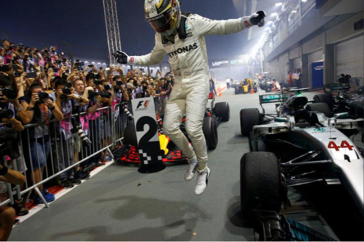 Lewis Hamilton celebrates winning yesterday's Formula One race in Singapore
