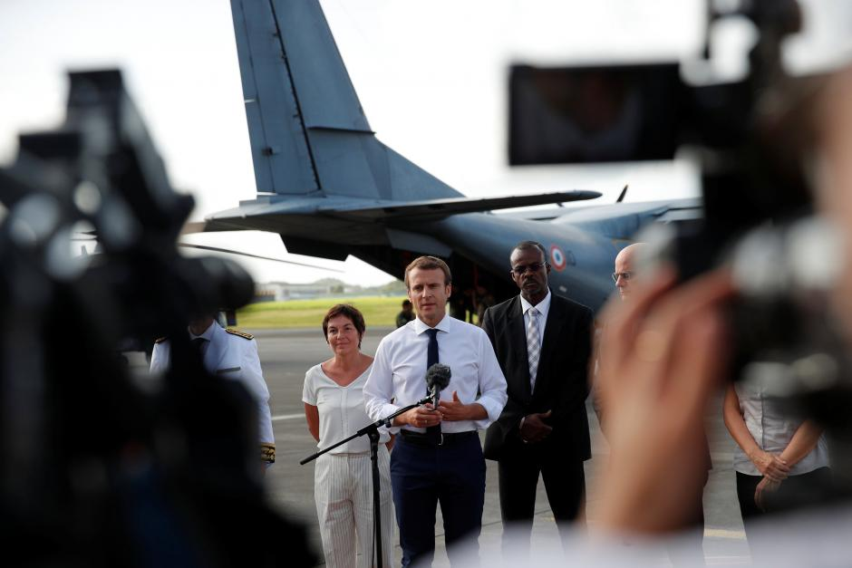 Macron follows Dutch king to devastated island
