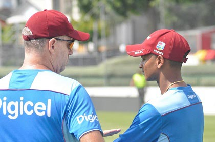 Head coach Stuart Law chats with wicketkeeper Shane Dowrich during a training session on Thursday