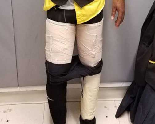 Airline worker caught with 9 pounds of cocaine taped to legs