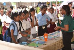 """Students from several secondary schools, and the Mahaicony Technical and Vocational Training Centre (MTVTC) in Region Five, were on Tuesday exposed to a number of possible career paths at a Career and Training fair The fair, hosted at the Mahaicony Technical and Vocational Training Centre, forms part of the National Youth Week 2018 activities and was described as very insightful by the students. """"This was an experience worth cherishing,"""" said 16-year-old Jerry Collins of the Mahaicony Secondary School. Collins, who plans to become an entrepreneur. (DPI photo)"""