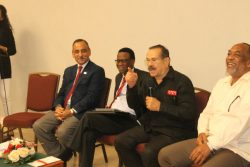 University of the West Indies Professor Emeritus of Mechanical Engineering, Clement Imbert as he interacted with the audience. He is flanked by other panellists.