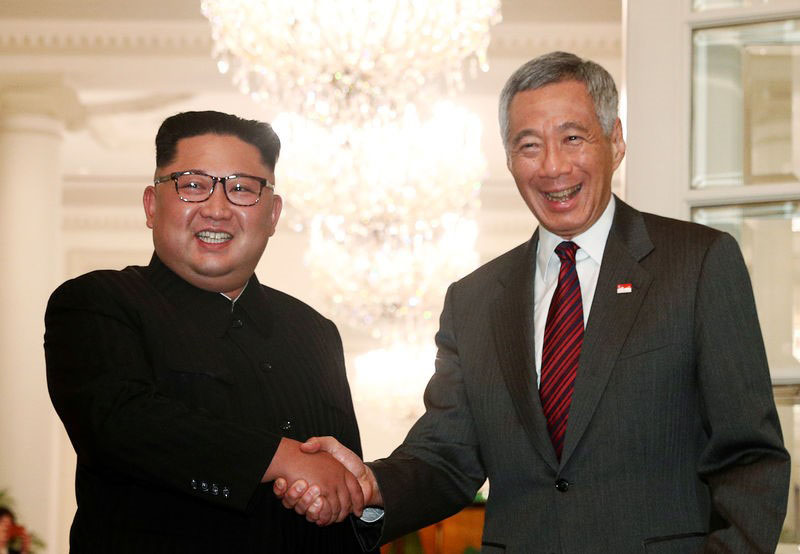 Reuters. North Korea's leader Kim Jong Un shakes hands with Singapore's Prime Minister Lee Hsien Loong at the Istana in Singapore