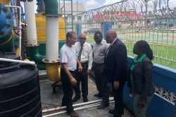 Minister of Natural Resources Raphael Trotman (second, from right) along with General Manager of the Guyana Gold Board Eondrene Thompson (right), Chairman of the Board GHK Lall (second from left) and Ministry of Natural Resources Communications Officer Johann Earle (third, from left) speaking to the contractor from ActLab Kevin Gomez yesterday.