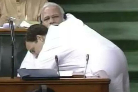 First, RaGa says PM can't see eye-to-eye, then hugs him