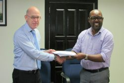 DHBC General Manager, Rawlston Adams (right) and Arie Mol of LievenseCSO (left) shaking hands following the signing of the contract in December of 2016.