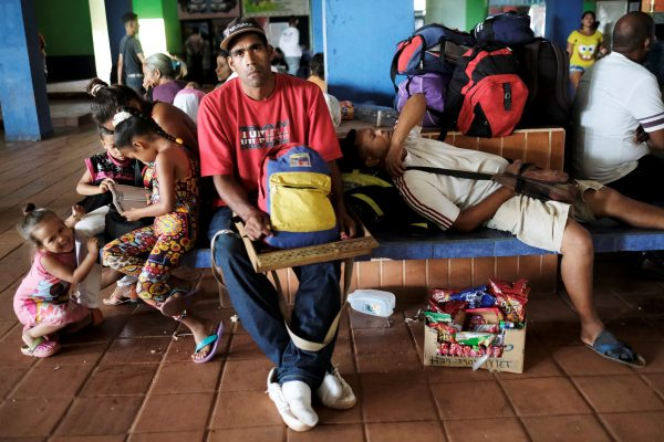 Venezuelans rest next to their belongings at a bus terminal, after being expelled from the Pacaraima border control point by Brazilian civilians, in Santa Elena, Venezuela August 19, 2018. REUTERS/Nacho Doce