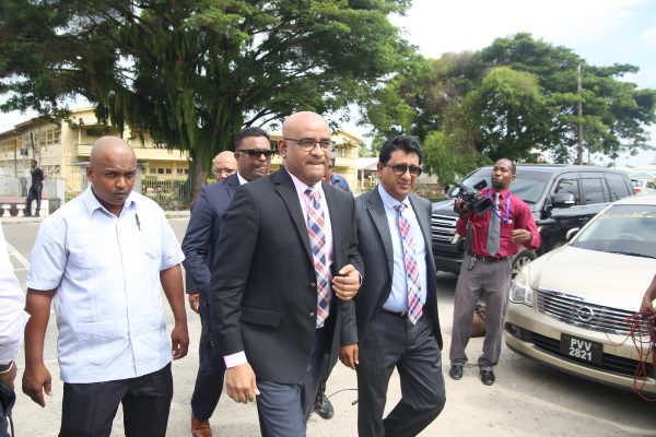 Former President Bharrat Jagdeo (second from left) arriving at the Special Organised Crime Unit (SOCU) headquarters on Camp Road yesterday. At right is attorney Anil Nandlall.
