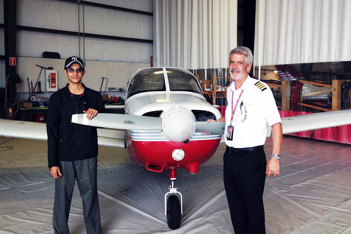 CHARGED Trini-born aviation student Nishal Sankat is seen at left in this