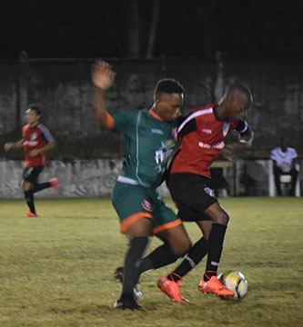 FLASHBACK!Ryan Hackett [center] of Fruta Conquerors challenging Rawle Gittens of Milerock for possession of the ball during their clash at the GFC ground, Bourda in the GFF Elite League recently.