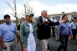 U.S. President Donald Trump and first lady Melania Trump walk through a neighborhood damaged by Hurricane Maria in Guaynabo, Puerto Rico, U.S., October 3, 2017. REUTERS/Jonathan Ernst/File Photo