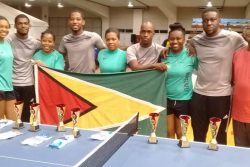 The Guyana male and female table tennis teams following their silver medals performances Monday night. At right is GTTA vice president Gary Pratt. Missing is U21 female player Priscilla Greaves.