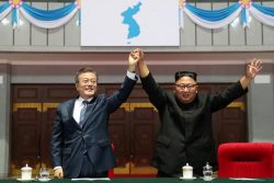"""South Korean President Moon Jae-in (left) and North Korean leader Kim Jong Un acknowledges the audience after watching the performance titled """"The Glorious Country"""" at the May Day Stadium in Pyongyang, North Korea, September 19, 2018. Pyeongyang Press Corps/Pool via REUTERS"""
