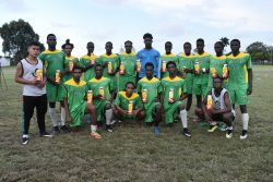 Members of the Golden Jaguars U-20 side displaying the supplements donated by the New Guyana Pharmaceutical Corporation (GPC) to aid in their preparation for the CONCACAF U-20 Championship.