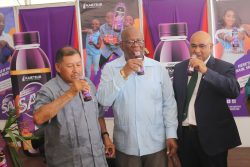 From left, Minister of Indigenous Peoples' Affairs, Sydney Allicock; Minister of Finance, Winston Jordan; and Dr Suresh Narine of the IAST sampling the new 'SAK' juice made of local purple sweet potatoes.