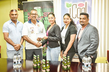 From left,  Guyana Floodlight Softball Cricket Association (GFSCA) vice-president, Jailall Deodass; GFSCA executive member, Ricky Deonarine; Ansa McAL's Marketing Assistant, Gabriell Lopes; Marketing Assistant, Olivia Chin and Beverage Divisional Head, Kelvin Singh.