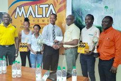 Clive Pellew, Brand Manager of Rainforest Water handed over a sponsorship cheque to President of the Athletics Association of Guyana (AAG), Aubrey Hutson, yesterday at Thirst Park following the launch of the 16th edition of the South American 10K event.