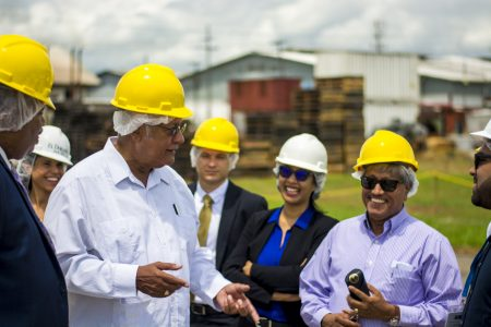 Agriculture Minister Noel Holder (second from left) and DDL Chairman Komal Samaroo (second from right) during the visit.