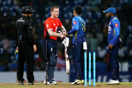 England captain Eoin Morgan, second left, shakes hands with Sri Lanka players after yesterday's match. (Reuters photo)