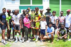 The top prize winners pose for a photo following the seventh annual Kadir Mohamed 'Ounce of Gold' road race yesterday on Homestretch Avenue. (Orlando Charles photo)