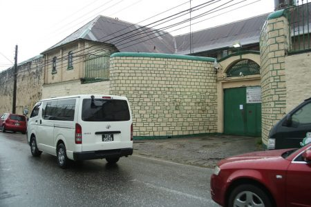 Vehicles pass by the Port-of-Spain prison on Frederick Street yesterday.