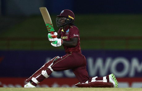 Deandra Dottin hits out during her top score of 46 against England in West Indies' final preliminary match on Sunday.