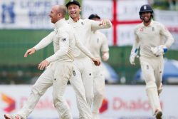 England's Jack Leach (L) celebrates with his teammate Jos Buttler (C) after taking the wicket of Sri Lanka's Malinda Pushpakumara (not pictured) and winning the match against Sri Lanka. REUTERS