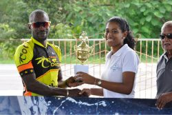 Junior Niles receiving his prize from Diamond Mineral Water Assistant Marketing Manager, Sherese Leander