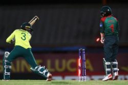 South  Africa's Faye Tunnicliffe looks back to see her stumps rattled during the final preliminary match of the ICC Women's T20 World Cup against Bangladesh on Sunday. (Photo courtesy ICC Media)