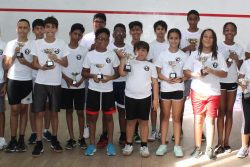 Participants in this year'sFarfan & Mendes Junior Skill level squash tournamentdisplay theirtrophies (Royston Alkins photo)