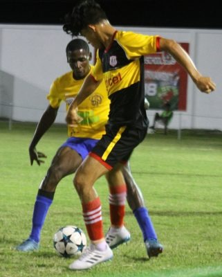 Action in the Annai (in black and yellow) and Shiva Boys Hindu College clash in the KFC Goodwill Football Championship at the Ministry of Education ground, Carifesta Avenue last evening. (Orlando Charles photo)  See page 29