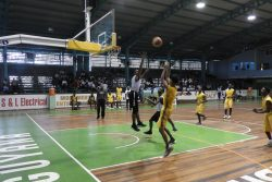 Action in the Mackenzie High and St Roses U19 clash of the Youth Basketball Guyana's 'Titan Bowl' at the Cliff Anderson Sports Hall, Homestretch Avenue.