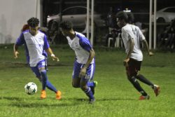 Action in the Turbo Knockout Football Championship finale between the Georgetown Football Club (in blue) and Northern Rangers at the Ministry of Education ground on Wednesday night. (Orlando Charles photo)