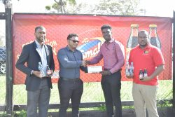 ANSA McAl's Non-Alcoholic Brand Manager Errol Nelson (left) looks on as I-Cool Brand Manager Fharis Mohamed hands over a cheque to Mark Alleyne (2nd from right) of the Petra Organisation. Also in the   photo is Petra's Co-Director Troy Mendonca,
