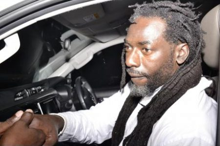 Buju Banton greeting fans after his return home.