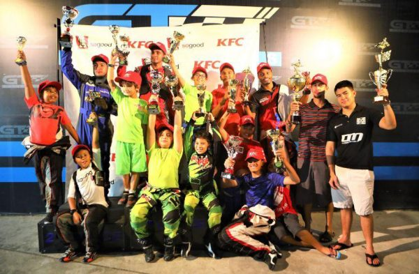 Prize winners of the second KFC Mega Cup Grand Prix pose for a photo following the event on Sunday at GT Motorsports.