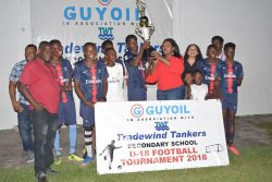 GuyOil's Marketing and Sales Manager handing over the winner's trophy to the Annandale captain, after the East Coast Demerara side captured the inaugural GuyOil/Tradewind Tankers U18 Secondary School Football Championship