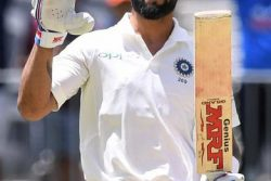India's captain Virat Kohli reacts after scoring his century on day three of the second test match between Australia and India at Perth Stadium in Perth, Australia, yesterday. AAP/Dave Hunt/via REUTER