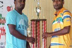 Lusignan 'A' vice-captain, Somdatt Bharrat (left) and Enmore CCCC captain, Beemraj Ramkelawan pose with the trophy.