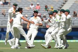 Australia's Mitchell Starc (3rd L) is congratulated by his teammates after dismissing India's Lokesh Rahul on day four of the second test match between Australia and India at Perth Stadium in Perth, Australia, yesterday.